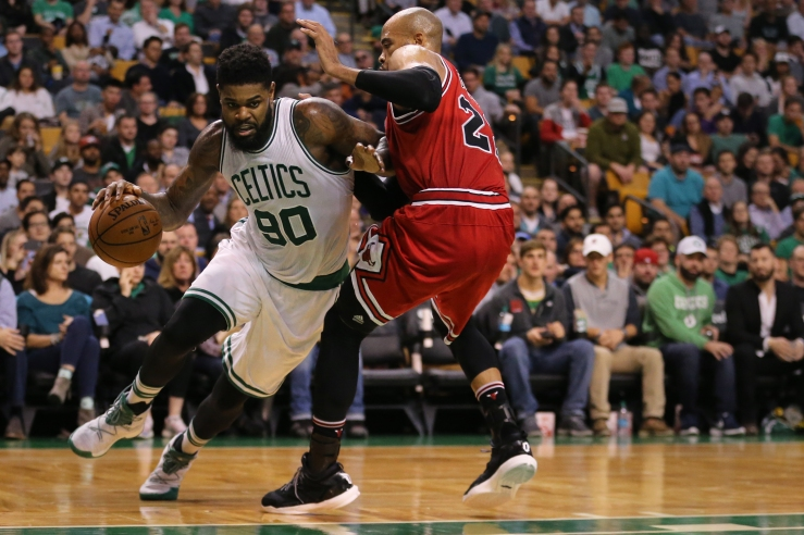 BOSTON, MA - NOVEMBER 2: Amir Johnson #90 of the Boston Celtics drives against Taj Gibson #22 of the Chicago Bulls during the third quarter at TD Garden on November 2, 2016 in Boston, Massachusetts. (Photo by Maddie Meyer/Getty Images)
